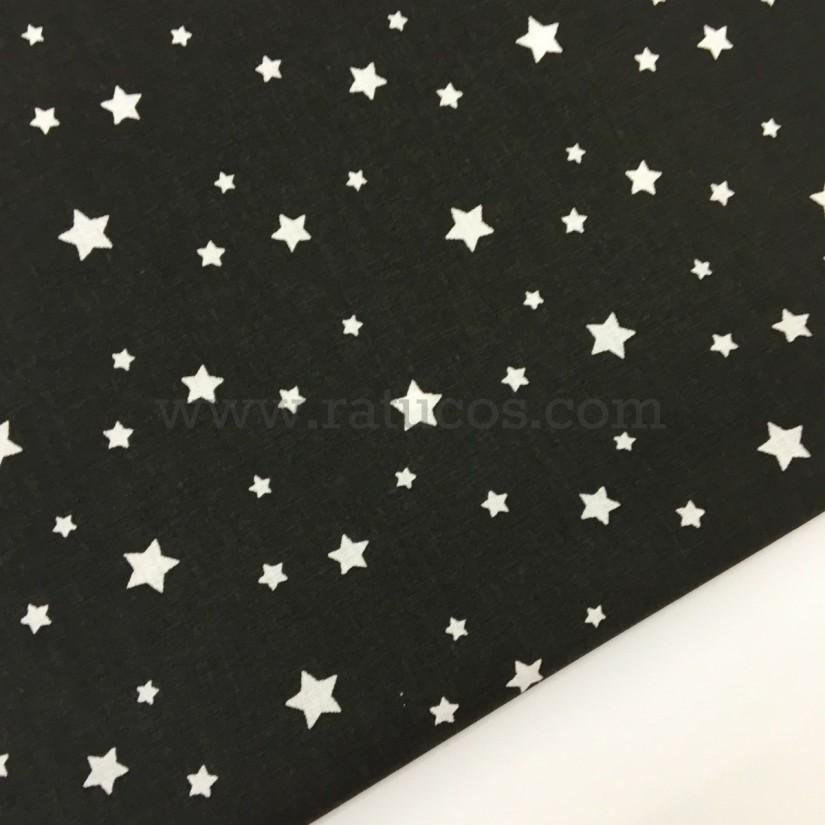 Tela de popelín, de ancho 150 cm. Estrellas  negro negativo, serie Argos.