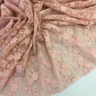 Tela de gasa de tul bordado en color rosa viejo