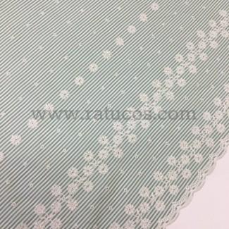 Tela de popelín con bordado en cenefas en ambos orillos