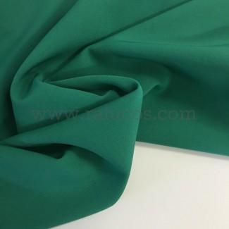 Tela de crepé con elastán en color verde esmeralda