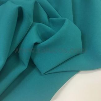 Tela de crepé con elastán en color turquesa