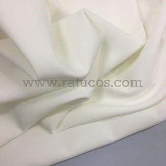 Tela de crepé con elastán en color marfil