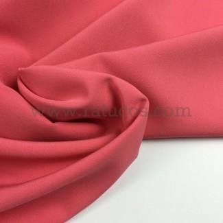 Tela de crepé con elastán en color rosa melocotón
