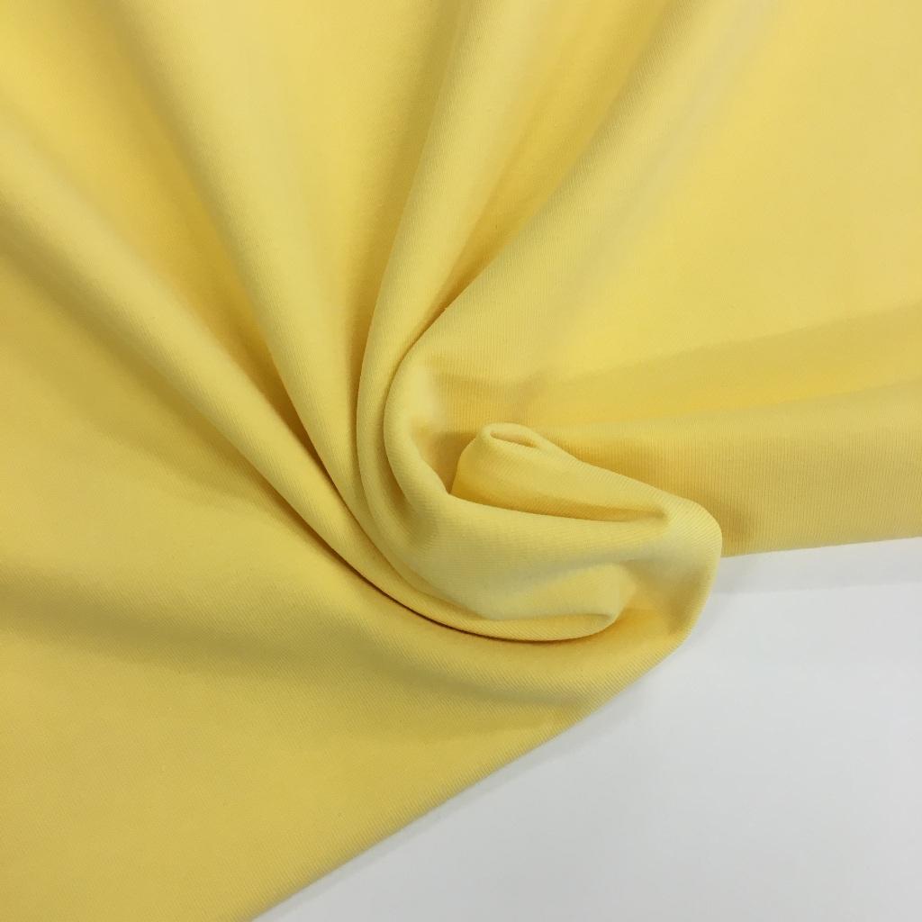 Tela de punto de camiseta en color amarillo suave