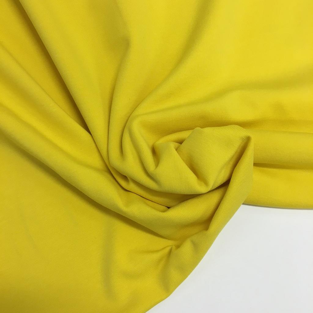Tela de punto de camiseta en color amarillo