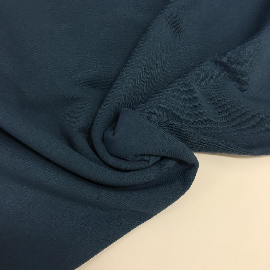 Tela de punto de camiseta en color azul jean